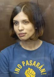 In this Aug. 17, 2012 file photo, Pussy Riot member Nadezhda Tolokonnikova sits in a glass enclosure at a court in Moscow, Russia.