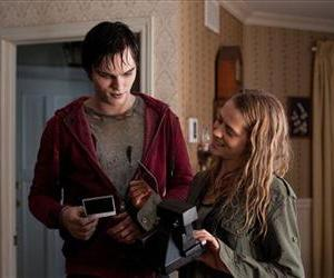 This film image released by Summit Entertainment shows Nicholas Hoult, left, and Teresa Palmer in a scene from Warm Bodies.