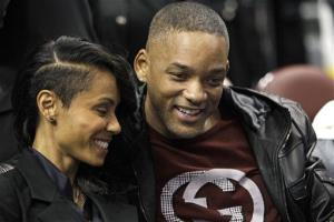 Will Smith, right, and wife Jada Pinkett Smith smile before an Philadelphia 76ers basketball game against the Charlotte Bobcats, Friday, Jan. 27, 2012, in Philadelphia.