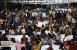 Mock hangmen's nooses hang during a protest demanding the death penalty for the men accused in the fatal gang rape of a young woman in New Delhi.