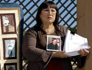Esther Miller holds newly released files of her abuser, the Rev. Deacon Michael Nocita, seen in middle picture, outside the Cathedral of Our Lady of the Angels in Los Angeles, Friday.