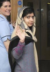 Malala Yousufzai says goodbye as she is discharged from the hospital to continue her rehabilitation while awaiting further surgery, in this file photo dated Friday, Jan. 4, 2013.