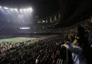 Fans and players wait for power to return in the Superdome.