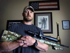 In this April 6, 2012, photo, former Navy SEAL and author of the book American Sniper Chris Kyle poses in Midlothian, Texas.