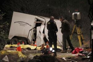 Investigators and body bags at the crash scene near Yucaipa, Calif.