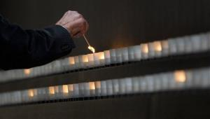 Nobel Peace Prize laureate and Holocaust survivor Elie Wiesel lights a candle as he tours the Hall of Remembrance at the Holocaust Memorial Museum.