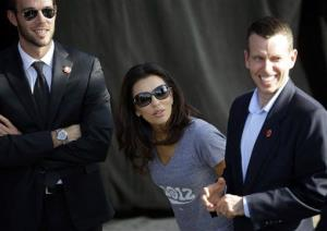 Eva Longoria, center, talks with Jon Favreau, left, and David Plouffe, right, during a campaign event at Cheyenne Sports Complex in Las Vegas, Nov. 1, 2012.