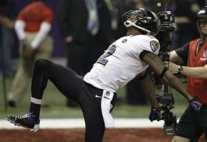 Jacoby Jones celebrates after returning a kickoff for a 108-yard touchdown against the 49ers during the second half of the NFL Super Bowl XLVII football game, Sunday, Feb. 3, 2013, in New Orleans.