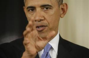 President Obama answers a question during a joint news conference.