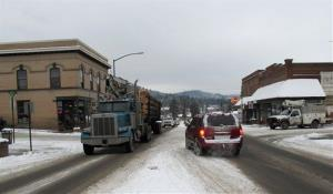 A logging truck moves through the center of St. Maries, Idaho, near where a survivalist group plans to build a compound.