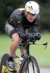 In this Oct. 7, 2012 file photo, Lance Armstrong competes in the Rev3 Half Full Triathalon, in Ellicott City, Md.