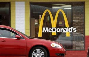 This Oct. 17, 2011, file photo shows the McDonald's logo on a McDonald's drive-through window in Springfield, Ill.