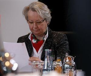 Annette Schavan reads files at the beginning of the weekly cabinet meeting at the chancellery in Berlin, Germany, Jan. 23, 2013.