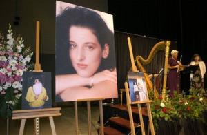 In this May 28, 2002 file photo taken at the Modesto Centre Plaza in Modesto, Calif. photos of Chandra Levy are on display as musicians, right, stand by at the memorial service for Levy.
