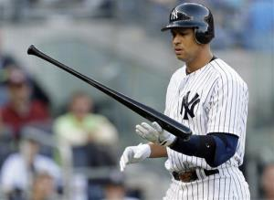 In this Oct. 14, 2012, file photo, New York Yankees' Alex Rodriguez walks back to the dugout.
