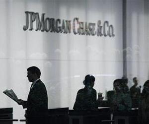 In this May 14, 2012, file photo, people arrive at JPMorgan Chase headquarters in New York.