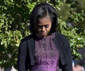 First lady Michelle Obama bows her head during a ceremony at the Pentagon memorial in this file photo.