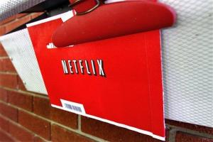 A Netflix envelope containing a DVD is clipped onto a mailbox, in Springfield, Ill.