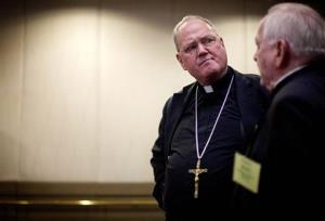 Cardinal Timothy Dolan, left, speaks with Hartford Archbishop Daniel Cronin Wednesday, June 13, 2012.
