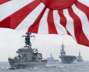 In this Oct. 14, 2012 photo, Japan Maritime Self-Defense Force (JMSDF) escort ship Kurama leads other vessels during a fleet review in waters off Sagami, south of Tokyo.