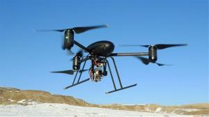 In this Jan. 8, 2009, photo provided by the Mesa County, Colo., Sheriff's Department, a small Draganflyer X6 drone is photographed during a test flight in Mesa County, Colo.