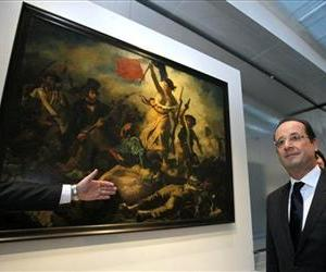 France President Francois Hollande stands in front of Liberty Leading the People, a painting by Eugene Delacroix, during the inauguration of the Lens, France, branch of the Louvre, Dec. 4, 2012.