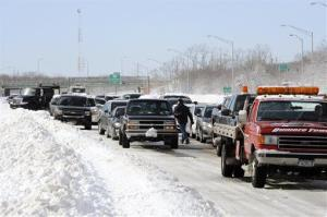 Traffic is backed up on the Long Island Expressway just west of Exit 59 Ocean Avenue as payloaders clear snow from the road after a storm, Saturday, Feb. 9, 2013, in Ronkonkoma , NY.