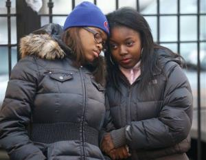 Tierra Woods, left, and Adriana Keith comfort each other after attending the wake of 15-year-old Hadiya Pendleton at the Calahan Funeral Home Friday, Feb. 8, 2013, in Chicago.