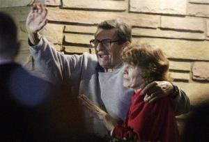 In this Nov. 9, 2011 file photo, Joe Paterno and his wife, Sue Paterno, stand on their porch to thank supporters gathered outside their home in State College, Pa.