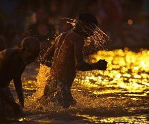 Hindu devotees take a holy dip at 'Sangam', the confluence of Hindu holy rivers Ganges, Yamuna and the mythical Saraswati, during the Maha Kumbh festival at Allahabad, India, Sunday, Feb. 10, 2013.
