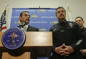 Los Angeles Mayor Antonio Villaraigosa, left, talks while Los Angeles Police Chief Charlie Beck looks on during a new conference at the Los Angeles police department in Los Angeles, Feb. 10, 2013.