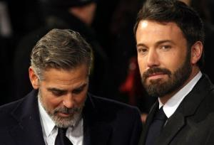 George Clooney, left, and Ben Affleck arrive for the BAFTA Film Awards at the Royal Opera House on Sunday, Feb. 10, 2013, in London.