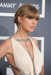 Taylor Swift arrives at the 55th annual Grammy Awards on Sunday, Feb. 10, 2013, in Los Angeles.