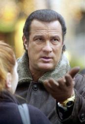 Actor Steven Seagal visits Warsaw's Old Town while shooting the movie Foreigner, in Poland, in this Jan. 31, 2002 file photo.