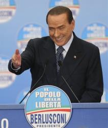 Former Italian Premier Silvio Berlusconi delivers his speech at a gathering of supporters in Milan, Italy, Sunday, Feb. 3, 2013.