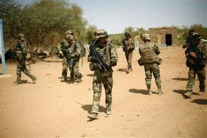 French soldiers secure the area where a suicide bomber attacked, at the entrance of  Gao, northern Mali, yesterday.