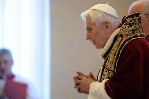 In this photo provided by the Vatican newspaper L'Osservatore Romano, Pope Benedict XVI delivers his message during a meeting of Vatican cardinals, at the Vatican, today.