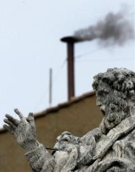 In this April 19, 2005, photo, black smoke billows from the chimney atop the Sistine Chapel at the Vatican, indicating that the cardinals gathered in the Conclave have not yet chosen the new pontiff.