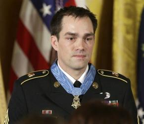 Medal of Honor recipient, retired Staff Sgt. Clinton Romesha is seen on stage during the ceremony in the East Room of the White House in Washington, Monday, Feb. 11, 2013.