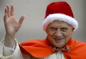 In this Dec. 21, 2005 file photo, Pope Benedict XVI, sporting a fur-trimmed hat, waves to pilgrims upon his arrival in St. Peter's Square at the Vatican for his weekly general audience.