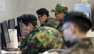 South Korean soldiers watch computer screens following a report about a possible nuclear test conducted by North Korea, at the Seoul train station in Seoul, South Korea, Tuesday, Feb. 12, 2013.
