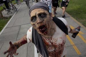 A man in zombie make-up, drenched in fake blood, poses for a photo as he parades in the annual Zombie Walk 2012 in Lima, Peru, Saturday, Dec. 1, 2012.