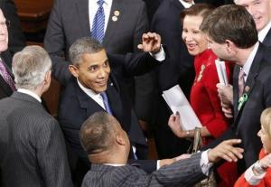 President Barack Obama is greeted after giving his State of the Union address during a joint session of Congress on Capitol Hill in Washington, Tuesday Feb. 12, 2013.