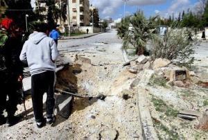 This citizen journalism image shows Free Syrian Army fighters next to a hole allegedly made during an airstrike by government forces, in Aleppo, Syria, Tuesday, Feb. 12, 2013.