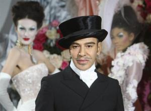In this Jan. 25, 2010 file photo, fashion designer John Galliano poses at the end of the presentation of the Dior Haute Couture spring/summer 2010 fashion collection in Paris.