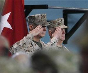 US Gen. John Allen, left, the outgoing US and NATO commander in Afghanistan salutes with his successor, Gen. Joseph Dunford during a changing of command ceremony in Kabul, Feb. 10, 2013.