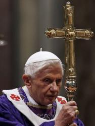 Pope Benedict XVI holds the pastoral staff during the celebration of Ash Wednesday Mass in St. Peter's Basilica at the Vatican Wednesday, Feb. 13, 2013.