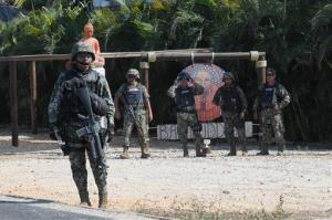 Mexican marines stand at a roadblock in Acapulco, Tuesday, Feb. 5, 2013.