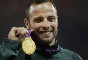 In this Saturday, Sept. 8, 2012, file photo, Oscar Pistorius poses with a Paralympic gold medal.