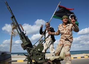 In this Tuesday Feb. 14, 2012 file photo, Libyan militias from towns throughout the country's west parade through Tripoli, Libya. With the two-year anniversary of the overthrown of Moammar Gadhafi coming, many fear violence.
